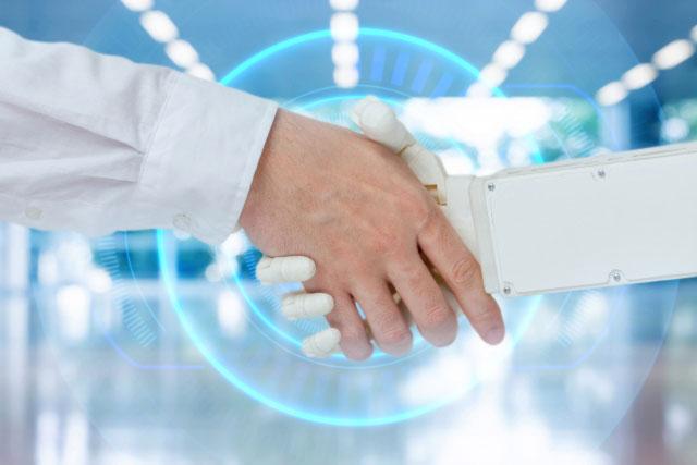 握手する人間とロボット